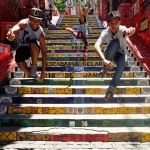 Passinho dancers jumping off the Escadaria Selarón Steps in Lapa in Rio de Janeiro, Brazil. Colorful mosaic!