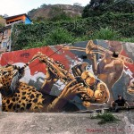 """""""Samba Sparks"""" - my mural in the largest favela in Brazil. Amazing to paint here. You can see this mural from the ground and across the favela. Such a pleasure to leave it here in Rio. Thanks to Reuben Rankin for the spot!"""